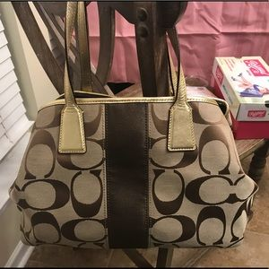 Authentic Coach Purse with leather gold straps.